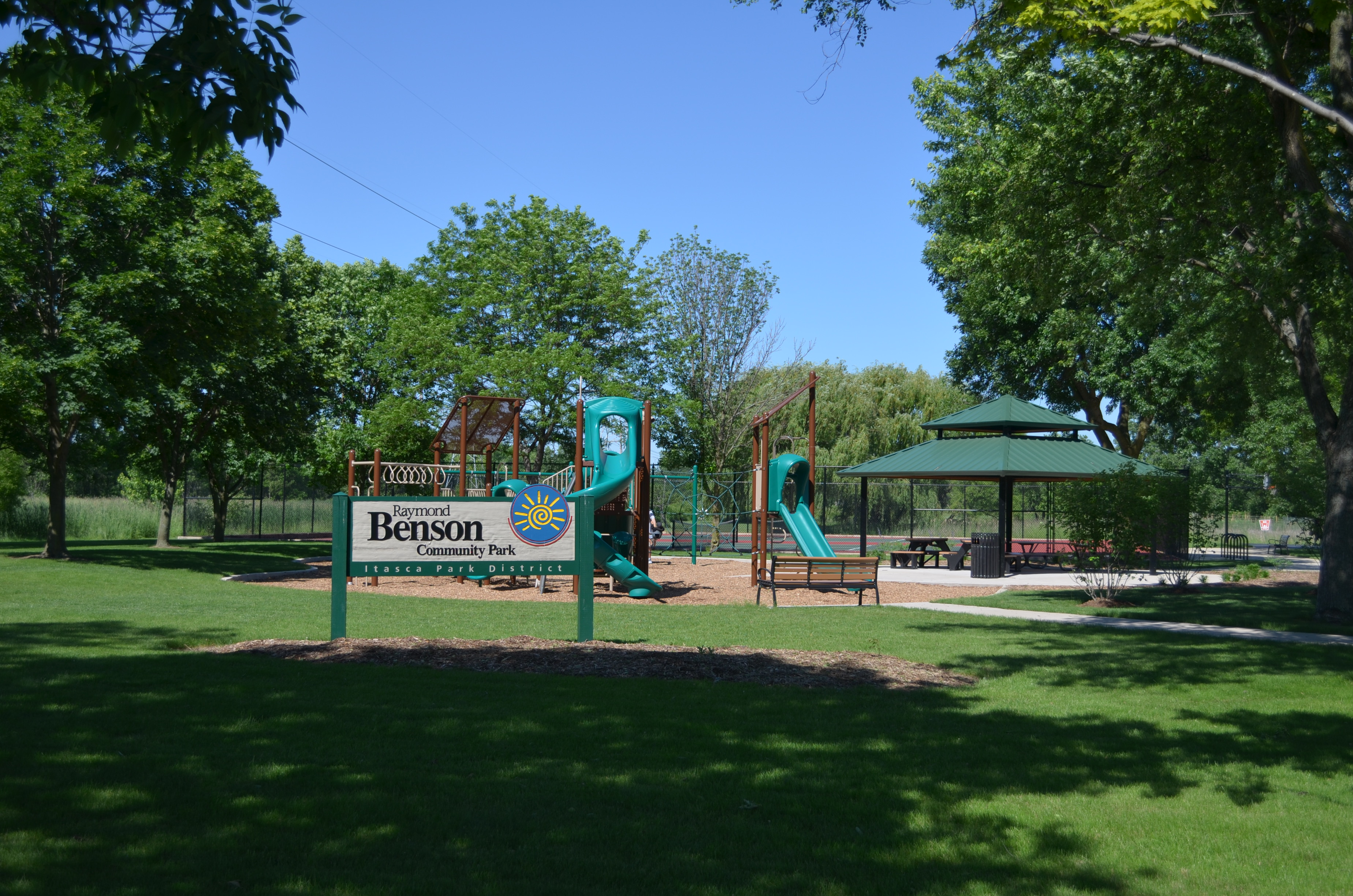 Benson Park Welcome Sign with the Jungle Gym in the Background